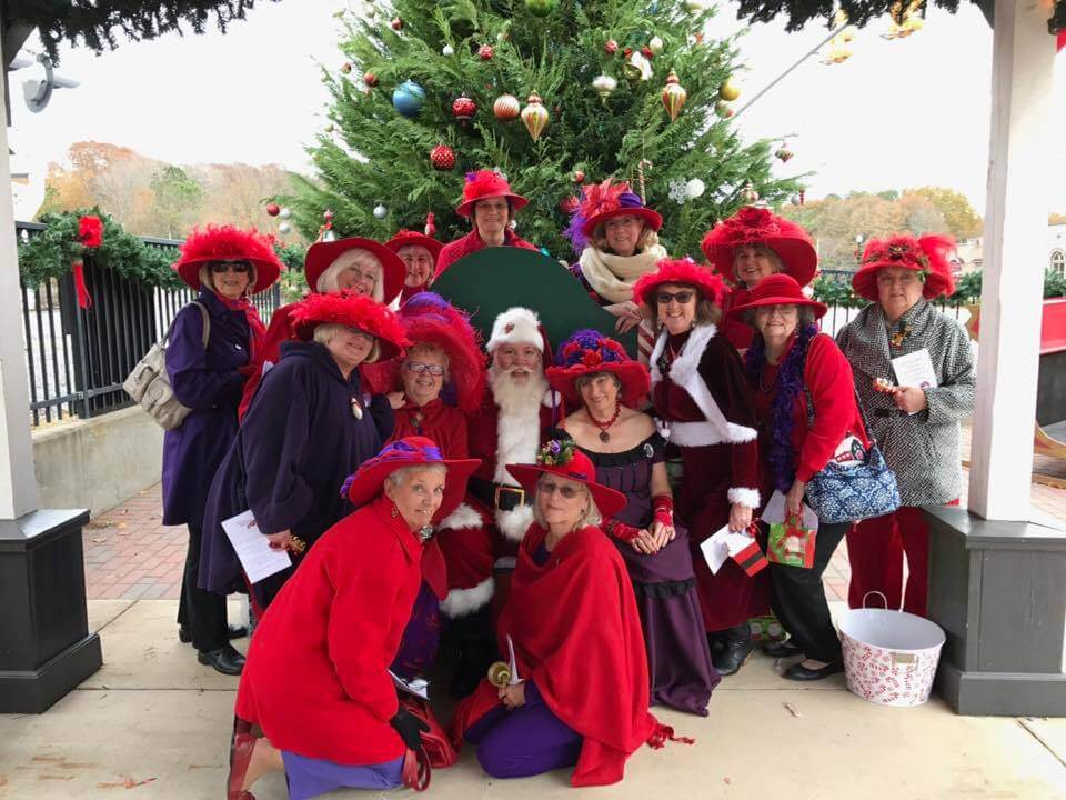 A group of Red Hat Ladies visited Santa during a visit to Historic Downtown to dine and shop. Photo by Michelle Berryman